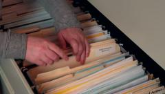 Pulling File from Filing Cabinet Stock Footage