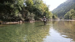 fisherman fly fishing in river - stock footage