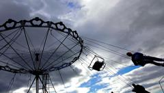 Merry-go-round silhouette on blue sky background at sunny day.sony 4k shoot Stock Footage