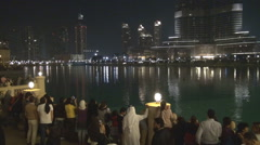 Burj Khalifa Lake Dubai Fountain tourist people wait water show landmark tourism Stock Footage