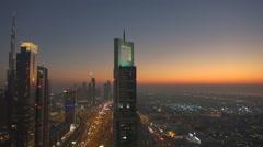 Aerial view Burj Khalifa tower famous building Dubai city traffic car twilight Stock Footage