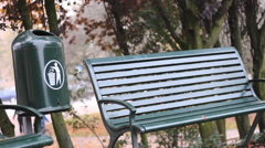 Trash can and bench in nature park outdoor Stock Footage