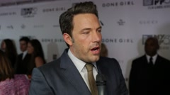Actor Ben Affleck interviewed on the red carpet about his film Gone Girl Stock Footage