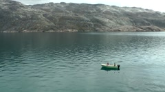 Greenland Prince Christian Sound 035 small motor boat in polar landscape Stock Footage