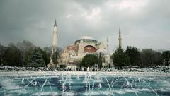 Famous historical artifact of Istanbul, Hagia Sophia Mosque and fountain clouds Stock Footage