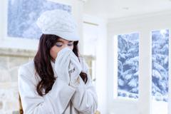 Woman using handkerchief for sneezing Stock Photos