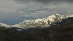 Icefall Peak and Canwell Glacier descending clouds and darkness Stock Footage