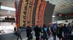 Checking flight information at the paris airport Stock Footage