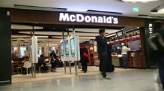 Mcdonalds inside paris airport Stock Footage