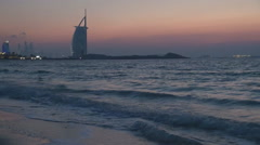 Burj Al Arab Atlantis resort sunset twilight famous Dubai landmark iconic beach  Stock Footage