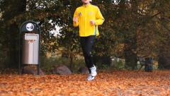 Man jogging in the park ,Trash can doggy Stock Footage