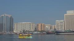 Touristic boat Creek river Deira cityscape sunny day Dubai downtown tourism fun Stock Footage