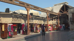 Traditional market place Dubai old town sunny day souq shopping road pedestrian  Stock Footage