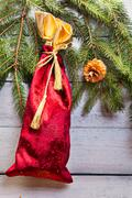 Christmas sack on wooden background Stock Photos