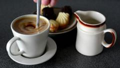 Coffee with milk - sweets (cookies) - stir coffee with spoon Stock Footage