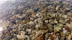 Stock Video Footage of shooting underwater stones on the bottom of the sea
