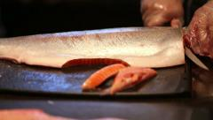 Cleaning and slicing fish 2 Stock Footage