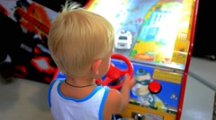 KOH SAMUI, THAILAND 19 JULY 2014 child plays in game room. HD. 1920x1080 Stock Footage