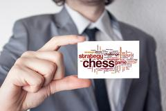 chess. businessman in suit with a black tie showing or holding business card. - stock illustration