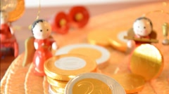 Christmas figure and euro coins, concept of spending Stock Footage