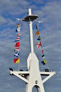 Mast and maritime signal flags - stock photo