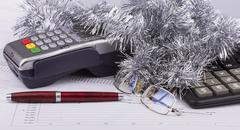 Business Christmas of payment terminal, calculator, pen, tinsel, eyeglasses Stock Photos