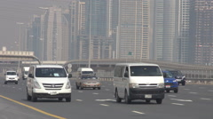 Marina skyscraper traffic car busy freeway Dubai cityscape metro line train pass Stock Footage