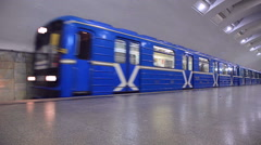 Blue subway train in motion at the station Stock Footage
