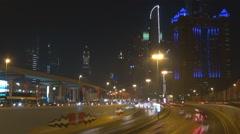 Timelapse heavy traffic car Dubai freeway downtown Sheikh Zayed Road night arab Stock Footage