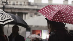Girl with a red umbrella, stood in the rain Stock Footage