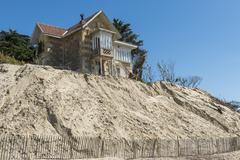house erosion at beach - stock photo