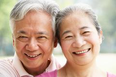 Head and shoulders portrait of a senior chinese couple Stock Photos