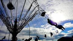 Chain swing ride silhouette on funfair, sony 4k shoot Stock Footage