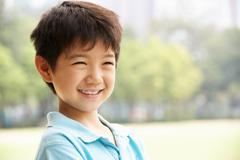 Head and shoulders portrait of chinese boy Stock Photos