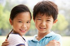 Head and shoulders portrait of chinese boy and girl Stock Photos