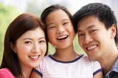 Portrait of chinese family with daughter in park Kuvituskuvat