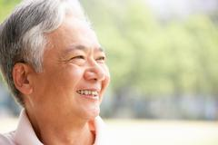 Head and shoulders portrait of senior chinese man Stock Photos
