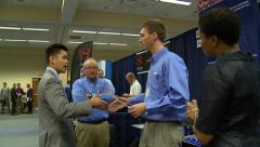 Job Fair Minority handshake Stock Footage
