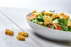 Close-up on a fresh caesar salad made of vegetables Stock Photos
