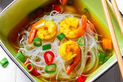 Chinese soup with shrimp and rice noodles Stock Photos