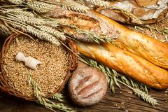 various kinds of fresh baked bread with grain - stock photo