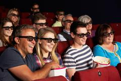 Teenage family watching 3d film in cinema Stock Photos