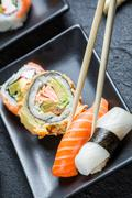 sushi eaten with chopsticks - stock photo