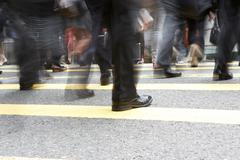 close up of commuters feet crossing busy hong kong street - stock photo