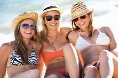 Group of teenage girls enjoying beach holiday together Stock Photos