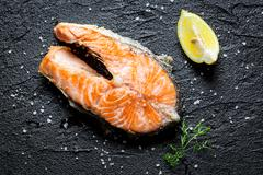 Freshly fried salmon served on a rock Stock Photos