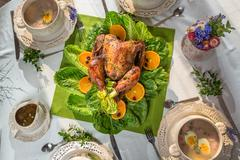 richly set table for thanksgiving with turkey and soup - stock photo