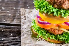 Homemade double-decker burger with vegetables Stock Photos