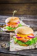 closeup of two homemade hamburgers - stock photo