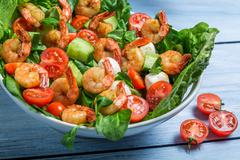 closeup of salad with vegetables and shrimp - stock photo